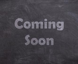 "The words ""Comming soon"" chalked on a blackboard"