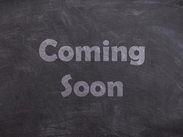 """The words """"Comming soon"""" chalked on a blackboard"""